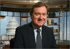 Moderator Tim Russert poses for a portrait at the set of Meet the Press in Washington.