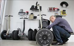 Jared Cavalier, owner of Segway of Ohio, works on one of the energy-efficient machines, June 5, 2008. He said he has seen a large increase in Segway sales in the past few months.