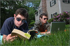 Doug Stone, 17, left, and his brother Mike Stone, 22, lie in the sun beside their Weston, Mass., home. Increased exposure to the sun and dietary supplements were prescribed after the boys were diagnosed with vitamin D deficiency.