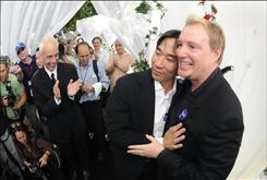 Paul Park, left, and Dean Larkin, right, married Tuesday in a civil ceremony in West Hollywood, Calif. California performed its first legally recognized same-sex weddings on Monday and opened its doors to gay and lesbian couples from around the country.