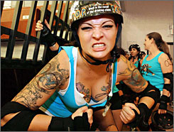 Tiffany Glasser, 29, aka Ginger Rum Punch, gets pumped up as her team, the Molly Rogers Rollergirls, takes on the Capital Punishment in Melbourne, Fla., in April.
