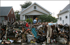 Household debris piles up on streets in Cedar Rapids, Iowa.