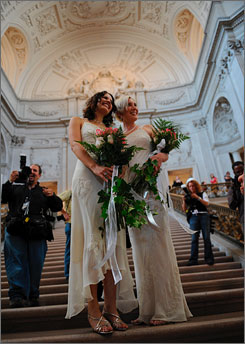 Sharon Papo, left, and Amber Weiss pose on the steps of city hall in San Francisco  pause on the steps inside city hall before on their wedding day on Tuesday.