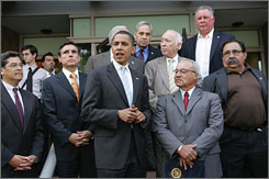 Many members of the Congressional Hispanic Caucus, which once supported Sen. Hillary Clinton, D-N.Y., in the presidential race, have switched their allegiance to presumed Democratic nominee Barack Obama, the senator from Illinois. Here, Obama is seen on Tuesday in Washingtin with caucus chairman Joe Baca, a California Democrat, and other members of the caucus.
