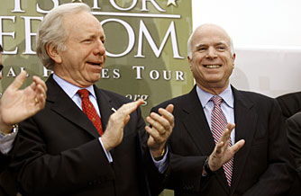 Republican presidential candidate, Sen. John McCain, right, is accompanied by Sen. Joseph Lieberman of Connecticut during an April ceremony with members of a veteran's group.