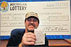 Mega Millions lottery winner Fred Topous, seen here on Tuesday in Lansing, Mich., is a registered sex offender.
