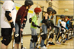 Students at Douglass Elementary School in Boulder, Colo., are instructed in skateboarding by the company Skate Pass during a physical education class.