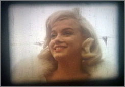 This image provided by Julien's Auctions shows behind-the-scene footage of Marilyn Monroe on the set of her last fully produced feature film, The Misfits.