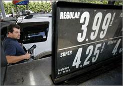 John McCarthy pumps gas at a Sunoco station in West Orange, N.J.