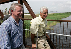 The state of Florida has purchased 187,000 acres of Everglades land from the United States Sugar Corp. Here, Florida Gov. Charlie Crist, right, and Lt. Gov. Jeff Kottkamp walk together in the Everglades on Tuesday, when they made the announcement.