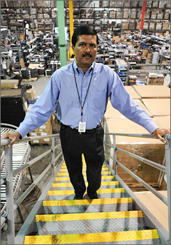 Nitin Dhopade, a naturalized citizen from India, looks over the floor at Micro Solutions Enterprises in Van Nuys, Calif. Dhopade is one of 114 citizens and LPRs who has filed claims for damages against the Deptartment of Homeland Security for violating the workers' rights and unlawfully detaining them during the raid.