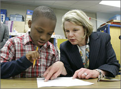 U.S. Secretary of Education Margaret Spellings helps third-grader Joe Lenton with a math problem at Sabal Palm Elementary School in Tallahassee, Fla. She visited the school Jan. 8, congratulating them on their progress in meeting No Child Left Behind requirements.
