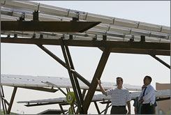 Michael Andrieu, left, shows Barack Obama shade structures with built-in solar-cell panels at Springs Preserve in Las Vegas.