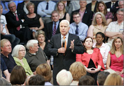 Republican presidential candidate Sen. John McCain takes part in a town hall meeting. McCain has repeatedly expressed his preference for town halls over set speeches.
