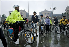 Philadelphia Mayor Michal Nutter, left, participates in National Bike to Work Day last month. The city launched a study to determine what type of bike-share program would work best,