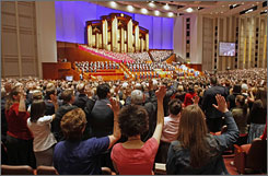 "Mormon Church members raise their hands at their annual conference in Salt Lake City, Utah, in April. ""Mormons have nothing whatsoever to do with this polygamous sect in Texas,"" said LDS church apostle Quentin Cook."