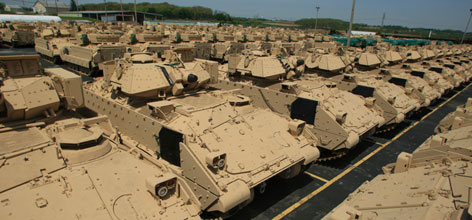 Dozens of completed and battle-ready Bradley fighting vehicles stand in a lot at BAE Systems in York, Pa. To watch video detailing the repair process see USA TODAY's look at the       multibillion-dollar Bradley repair lifeline.