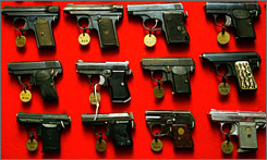 The Supreme Court has struck down Washington's gun ban. Here, a collection of guns confiscated by Washington's local police department is seen.