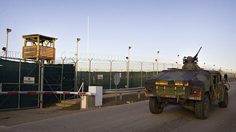 In this image reviewed by the U.S. Military, soldiers in a Humvee patrol the perimeter of the Camp Delta detention compound at Guantanamo Bay U.S. Naval Base, in Cuba.