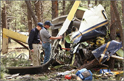 NTSB and FAA investigators survey the wreckage Monday from the fatal medical helicopter crash in Flagstaff, Ariz.