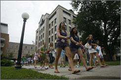 Incoming freshman walk across the Tulane University campus in New Orleans.