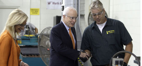 Sen. John McCain shakes hands with Mike Younts as wife Cindy McCain looks lon during a tour of the Worth and Company factory in Pipersville, Pa. Monday.
