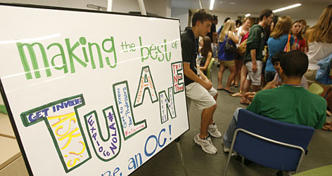 "New students attend freshman orientation at Tulane University. Inside the bubble letters of ""TULANE"" is written ""get involved, ask ?s,"" ""explore NOLA,"" ""get to know your professors,"" ""activities,"" ""meet new people"" and ""try new things."""