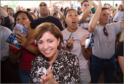 A government report shows Hispanic voters are gaining in numbers in some closely contested states. Here, Hispanic voters are seen at a rally supporting Democratic presidential contender Barack Obama in San Antonio on June 24.