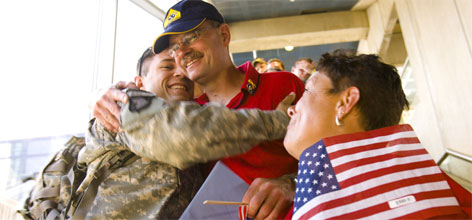 Pfc. Justin Gindhart of Warminster, Pa., hugs his father, Mark, as they leave Philadelphia International Airport last Father's Day. His mother Lisa Gindhart looks on.