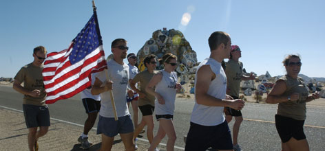 Runners pass the Painted Rocks at Fort Irwin, Ca. during the first mile of the Run for the Fallen.
