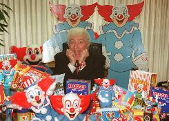 Larry Harmon, shown here in his Los Angeles office Jan. 10, 1996, appeared as Bozo the Clown for decades.