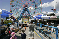 People attend Astroland park in the Coney Island section of Brooklyn in New York.