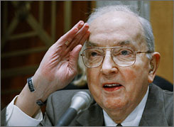 Former U.S. Senator Jesse Helms salutes Secretary of State Colin Powell during a Senate Foreign Relations Committee meeting in February 2002.