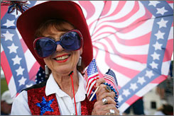 Shirley Anderson watches during the Independence Day parade, Friday, in Wimberley, Texas.