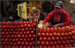 A worker separates tomatoes at the sprawling Central de Abastos market in Mexico City last month. FDA inspectors are collecting samples to determine the source of a salmonella outbreak.