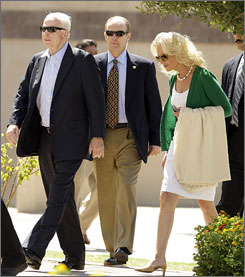 Republican presidential candidate Sen. John McCain, R-Ariz., left, and his Cindy McCain, right, walk into worship service Sunday at the North Phoenix Baptist Church in Phoenix.