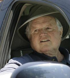 Sen. Edward Kennedy, D-Mass., waved as he returned to his Hyannis Port, Mass. home, Monday, June 9, 2008, after undergoing surgery a week earlier, which experts said was designed to reduce his brain tumor and give chemotherapy and radiation treatments a chance to work.