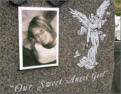 This May 2008 picture shows a portrait of Jenna Foellmi on her gravestone in Brownsville, Minn. Jenna, a student at Winona State University, died Dec. 14, 2007 after a night of drinking. Between 1999 and 2005, 157 people between the ages of 18-23 died from drinking so much alcohol that their bodies stopped working.