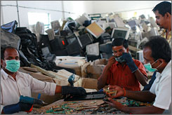 Workers dismantle old computers and gadgets at an electronic waste recycling factory in Dobbspet, India. About 80% of U.S.-generated e-waste is exported to India, China and Pakistan to be recycled, according to the Karnataka, a state pollution control board.