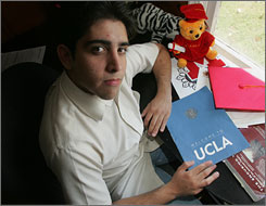 Matias Bernal, an illegal immigrant from Mexico City, holds a folder from a visit to his favorite school, UCLA, in July 2006. Bernal was wait-listed at Princeton, but without access to financial aid and most scholarships, he had to prepare to attend California State University in Fresno, Calif., so he could live at home and pay tuition with money from jobs he's not supposed to have.