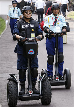 Security officers on Segway personal transporters patrol around Rusutsu town, on Japan's northern island of Hokkaido.
