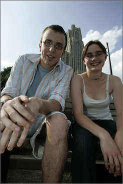 Dan  Hackett, who has Asperger's syndrome, sits with his peer mentor Kelly Coburn in front of the Cathedral of Learning at the University of Pittsburgh.