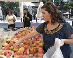 "Tiffany Nicosia shops at the Unity Farms Fresh Local Produce stand in Charlotte. ""The other day I got four kiwis, two apples, one pound of green beans, a bunch of red potatoes and three oranges for $4."""