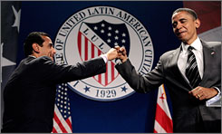 "Los Angeles Mayor Antonio Villaraigosa, left, gives a ""fist bump"" to presumptive Democratic presidential nominee Barack Obama during the national convention of the League of United Latin American Citizens (LULAC) at the Washington Hilton Tuesday in Washington, DC. Obama has been recently criticized for moving to the political center after calling for a slowing of withdrawal of troops from Iraq, supporting a proposed wiretap law and government funding of faith-based programs."