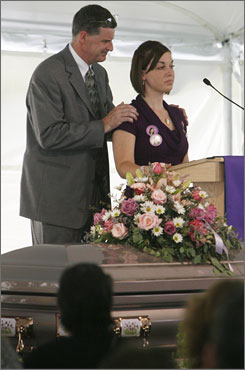 Pastor Tom Hardy, left, comforts Savanna Andress, the sister of Brooke Bennett, during Bennett's funeral service, Wednesday, in Randolph, Vt.