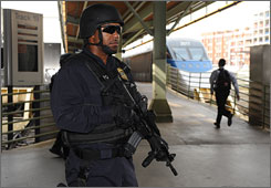 Amtrak policeman Douglas Davison watches passengers boarding a train at Union Station in Washington, D.C.