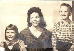 Betty Neumar, center, is shown with son Gary Flynn, right, and daughter Peggy Flynn. Authorities are now examining the deaths of four of her five husbands. Neumar, now 76, was charged last month in North Carolina with solicitation of murder in the July 14, 1986 shooting death of her fourth husband, Harold Gentry. Her grandson is urging police to re-examine the supposed 1985 suicide of his stepfather, Neumar's son Gary.