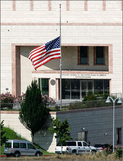 A U.S. flag flies at half-mast outside the U.S. consulate in Istanbul, Turkey, where an attack by gunmen on Wednesday left three gunmen and three police officers dead. A Turkish newspaper reports the getaway driver in the attack was hired and had nothing to do with planning the incident.