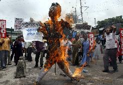 Activists from the Socialist Unity Centre of India burn an effigy of India's Prime Minister Manmohan Singh during a protest Friday against the nuclear deal with the U.S. in the northeastern Indian city of Siliguri.