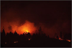Fast-moving flames burned at least seven homes in Spokane Valley, Wash. and forced 200 residents to evacuate.